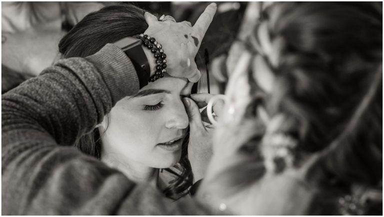 Makeup artist gina applying makeup on bride